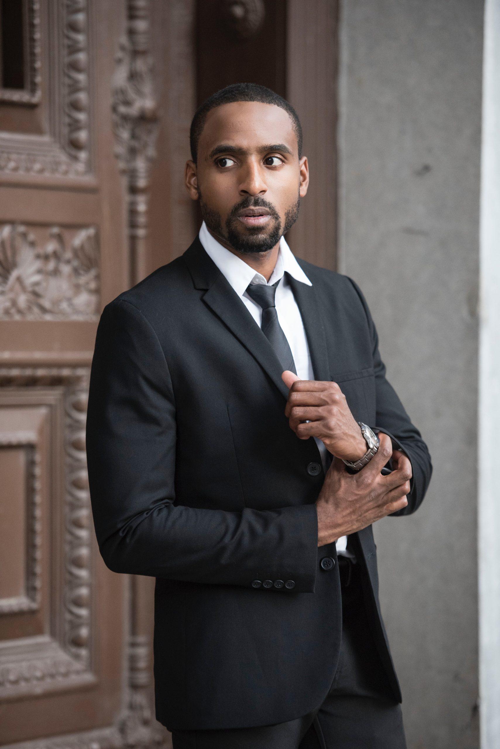 man-wearing-black-notched-lapel-blazer-2955375